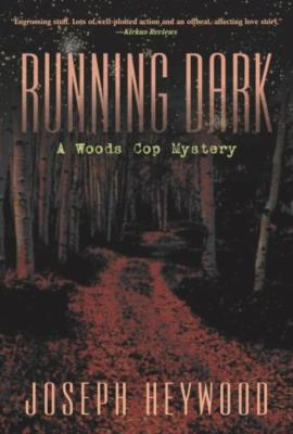 Running Dark: A Woods Cop Mystery 9781592286171